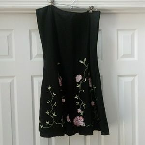 Black flare skirt with pink flower embroidery